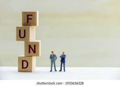 Risky asset investment with risk of portfolio collapsing, financial concept : Businessmen or fund manager talk or discuss near square cubes, depict exchanging ideas on bond market chance and situation