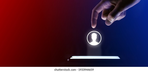Man finger clicks on the user icon person.User symbol for your web site design, logo, app, UI. Which is a virtual projection from a mobile phone. Neon , red blue lights