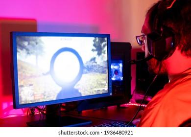 Guy streaming while playing shooting game