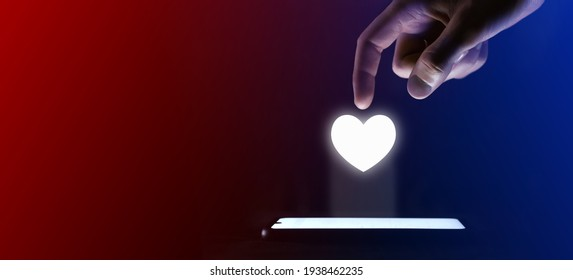 Man finger clicks on the heart like icon. Heart like lock symbol for your web site design, logo, app, UI. Which is a virtual projection from a mobile phone. Neon , red blue lights
