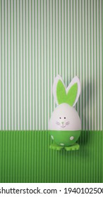 Kreatives Konzept Ostern Grußkartenlayout, grüner Kartonhintergrund mit Eierkaninchen.