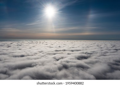 sunrise on blue sky. Blue sky with some clouds. View over the clouds.