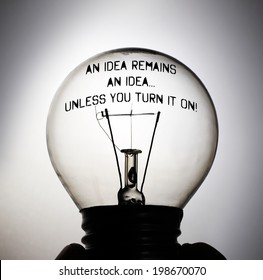 Silhouette of an incandescent light bulb with the message: An Idea remains an idea unless you turn it on!