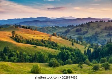 Beautiful green hills at dusk. Carpathian, Ukraine, Europe. Beauty world.
