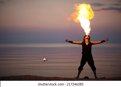 Showman performing amazing fire-breathing