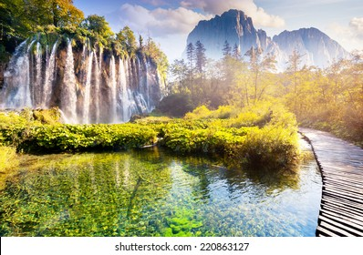 Majestic view on waterfall with turquoise water, sunny beams in the Plitvice Lakes National Park. Forest glow by sunlight. Croatia. Europe. Dramatic morning scene. Beauty world. Creative photo collage