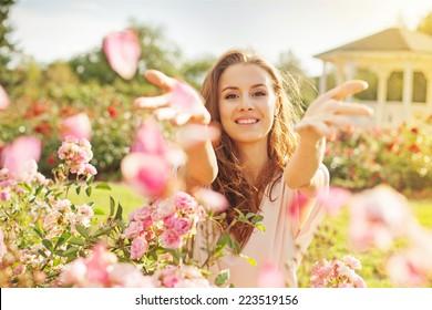 woman throwing rose petals