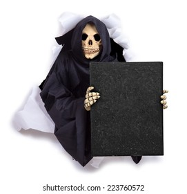 Grim Reaper with an billboard. The Grim Reaper is peering from a hole in the wall and holding a blackboard. Skeleton showing a blank poster. Grim reaper through the hole shows blank poster.