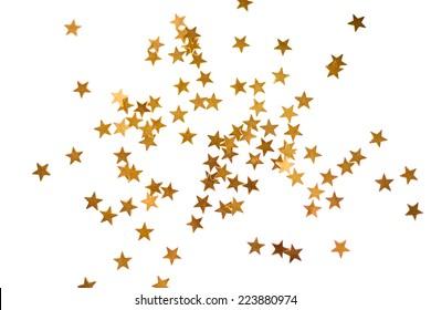 白で隔離の小さな金色の星と休日の背景