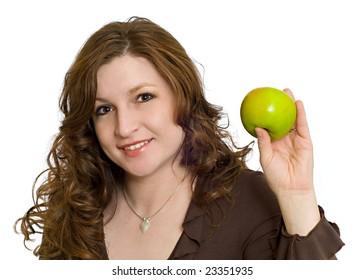 健康的な食事と生活を象徴する新鮮な青リンゴを笑顔で保持しているきれいな女性