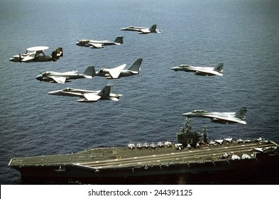 Aircraft assigned to the nuclear-powered aircraft carrier USS GEORGE WASHINGTON fly over the ship. Oct. 25 1992.