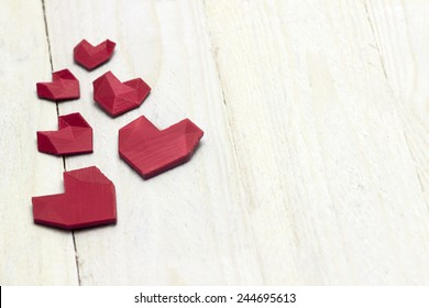 Lovely red heart's on the white wood floor template. Photography of 3d printed object.