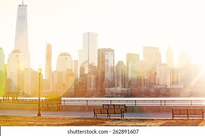 Dawn sunshine breaking over lower Manhattan with natural lens flare