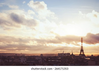 sunset sky over Paris, beautiful panoramic view with silhouette of Eiffel tower, warm colors