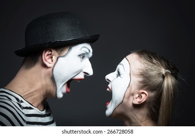 Couple of mimes furiously shouting at each other