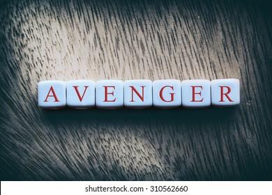 AVENGER word written on white cubes