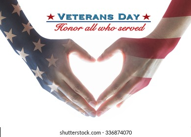 USA Veterans day with United Stated of America flag pattern on people's hands in heart shape and greeting announcement honoring all who served American country