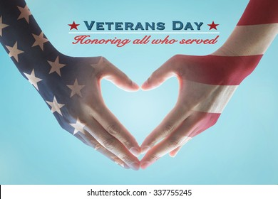 Veterans day with American flag pattern on people's hands in heart shape