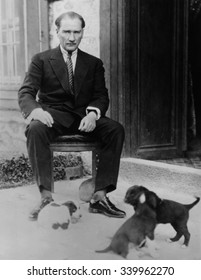 Mustafa Kemal Ataturk, President of Turkey, with his pet dogs, ca. 1930. As part of Kemal's modernization and Westernization of Turkey, he encouraged the acceptance of dogs, and the end to their relig