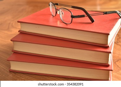Book with a red cover with glass