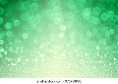 Abstract green glitter sparkle confetti spring background or party invitation