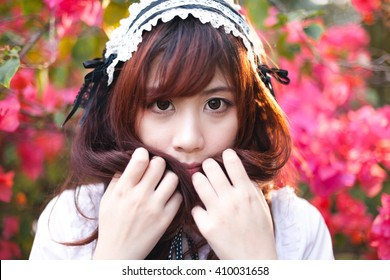 Charming Asian girl in japanese maid costume in film color style