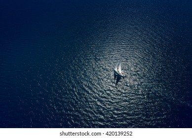 Amazing view to Yacht sailing in open sea at windy day. Drone view - birds eye angle. Yachting theme.