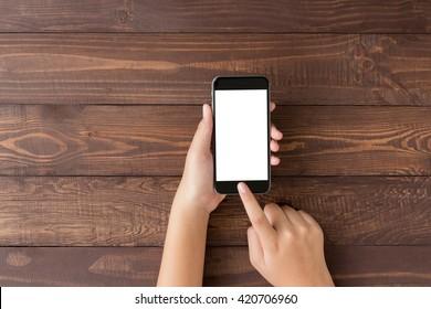 Hand mit Telefon leeren Bildschirm auf Draufsicht