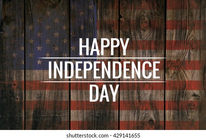 Inscription Happy independence day on usa flag. Grunge background. Wooden texture.