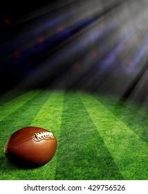 スポットライトのある緑の野原でのアメリカンフットボール