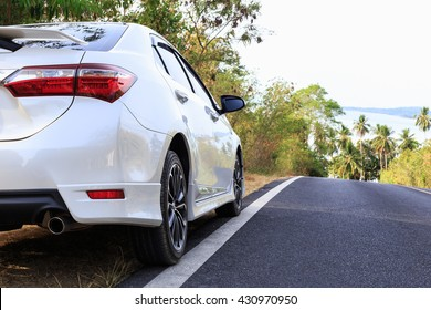 Nakhon Si Thammarat , THAILAND - May 22 : Car, Toyota Corolla Altis parking on the asphalt road in on May 22, 2016. The official dealer of Toyota who is the top market share for commercial car.