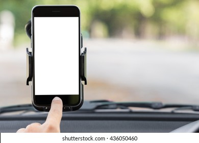 close up hand use phone on mount in car
