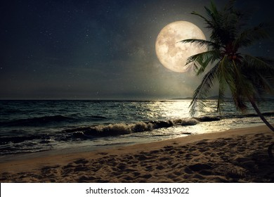 Beautiful fantasy tropical beach with Milky Way star in night skies, full moon - Retro style artwork with vintage color tone (Elements of this moon image furnished by NASA)