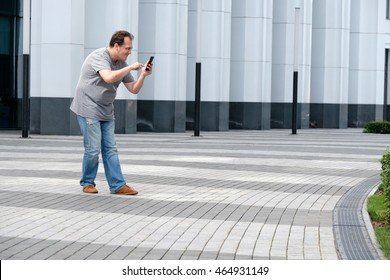 Man playing mobile game at the modern city background