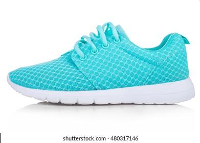 白い背景で隔離の女性の運動靴