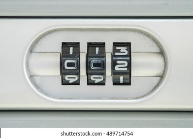 Closeup code number for lock the old suitcase background with 002 password