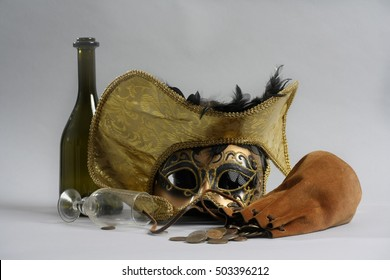 Nature mort a set consisting of hats, masks, bottles, shells, and coins.
