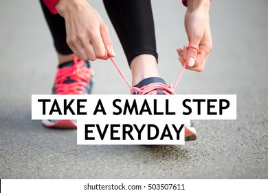 """Female hands tying shoelace on running shoes before practice. Woman athlete preparing for jogging outdoors. Sport active lifestyle concept. Motivational text """"Take a small step everyday"""""""