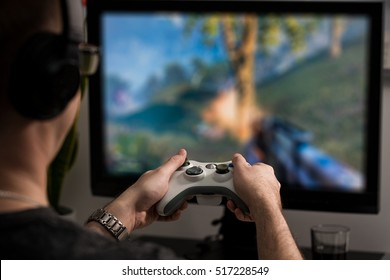 gaming game play tv fun gamer gamepad guy controller video console playing player holding hobby playful enjoyment view face concept - stock image