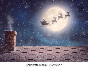 メリークリスマスとハッピーホリデー!背景の月の空にそりで飛んでいるサンタクロース。クリスマスの物語のコンセプト。