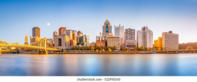 Long exposure of Pittsburgh downtown skyline and Roberto Clemente bridge, on a sunny afternoon, as viewed from North Shore Riverfront Park, across Allegheny River.