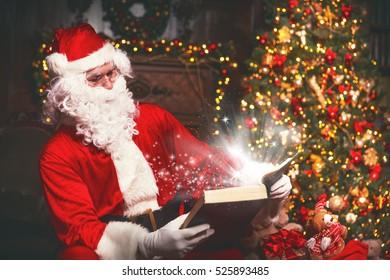 Santa Claus at Christmas with glowing magical book