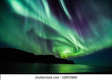 Icelandic spiral northern lights in autumn time
