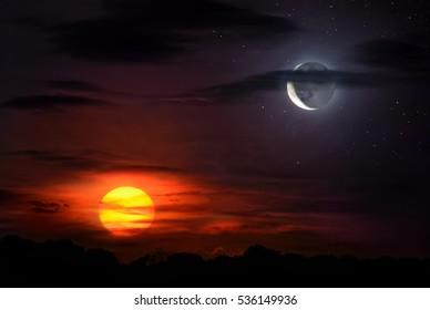 時間、反対、バランスなどを象徴する空に太陽と月が一緒に