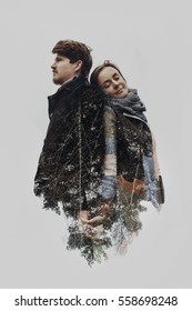 stylish romantic couple in double exposure with tree branches in park. sensual atmospheric moment with space for text. man embracing gently hugging woman. creative unusual photo. earth day