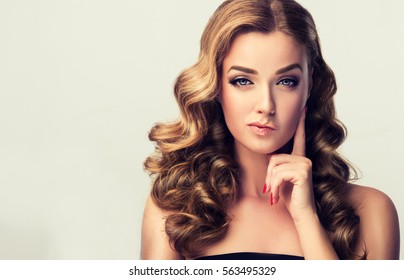Frowning, woman  disbelief thinking .Girl thinking about something .Beautiful girl with curly hair with expressive facial expressions
