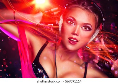 Young sexy brunette woman dj with headphones portrait. Anime style portrait with big eyes and energy flow effect.