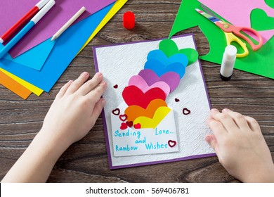 Birthday, Mother's Day or Valentine background. Greeting card with paper rainbow hearts, sending love and rosy wishes. Children's art project, a craft for children. Craft for kids.