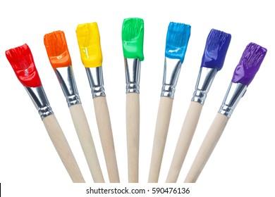 虹の色のシンプルな白いショットで分離されたカラフルなペイントブラシ
