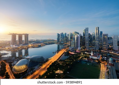 Aerial view of Singapore business district and city at twilight in Singapore, Asia